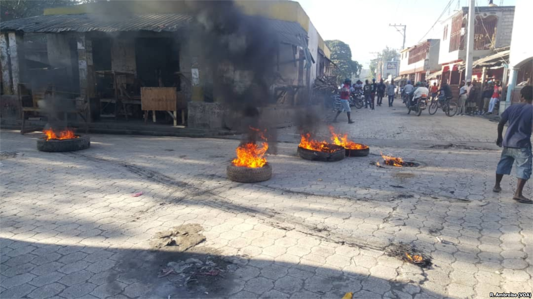 Flaming tires seen early on February 11, 2019, in the streets of Hinche in the center of Haiti.
