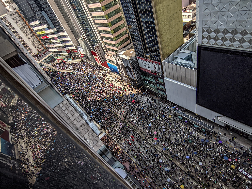 Tens of thousands of protesters took to the streets in Hong Kong on Tuesday, even though protests weren't allowed.
