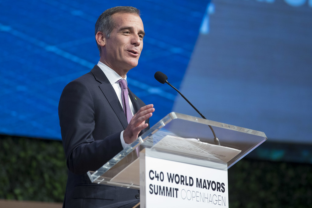 Los Angeles Mayor Eric Garcetti is shown speaking at a group of mayors from around the world. He says he'll ask for US mayors to be allowed to join the United Nations meeting on the climate crisis in Santiago, Chile in December.