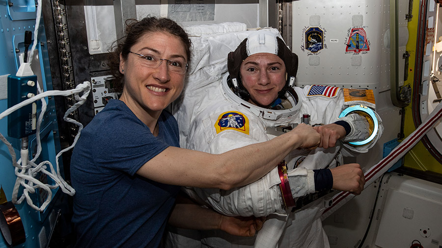 Christina Koch (left) and Jessica Meir getting ready for their spacewalk on Friday.