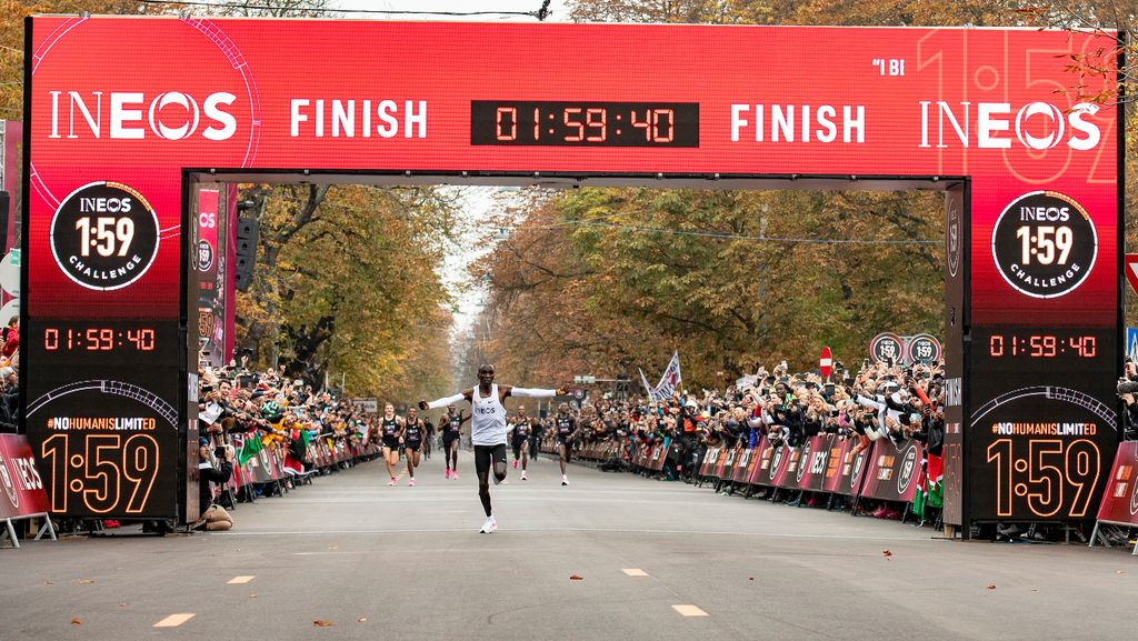 Eliud Kipchoge celebrates as he crosses finish line and makes history to become the first human being to run a marathon in under 2 hours. The INEOS 1:59 Challenge, Vienna, Austria. 12 October 2019.