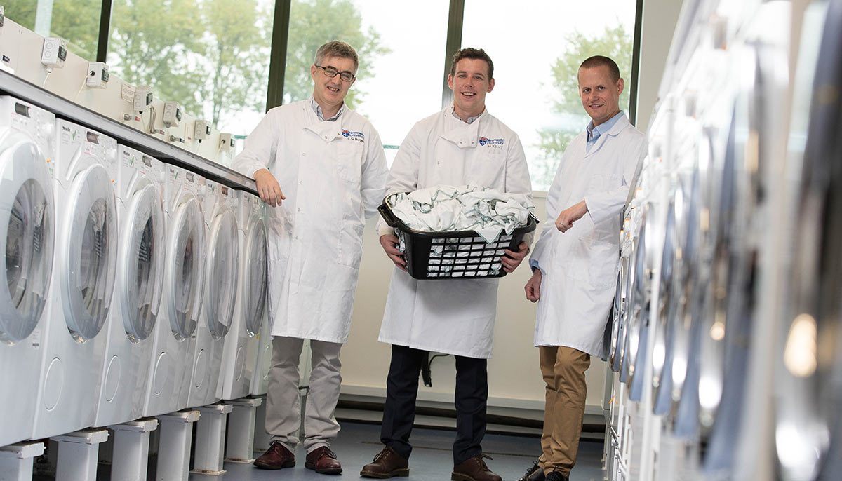 Grant Burgess, Max Kelly, and Neil Lant in the washing machine laboratory.