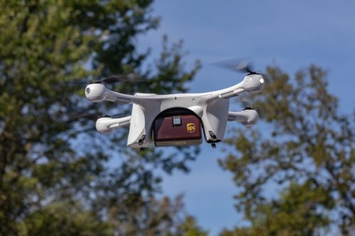 Drone carrying UPS package.