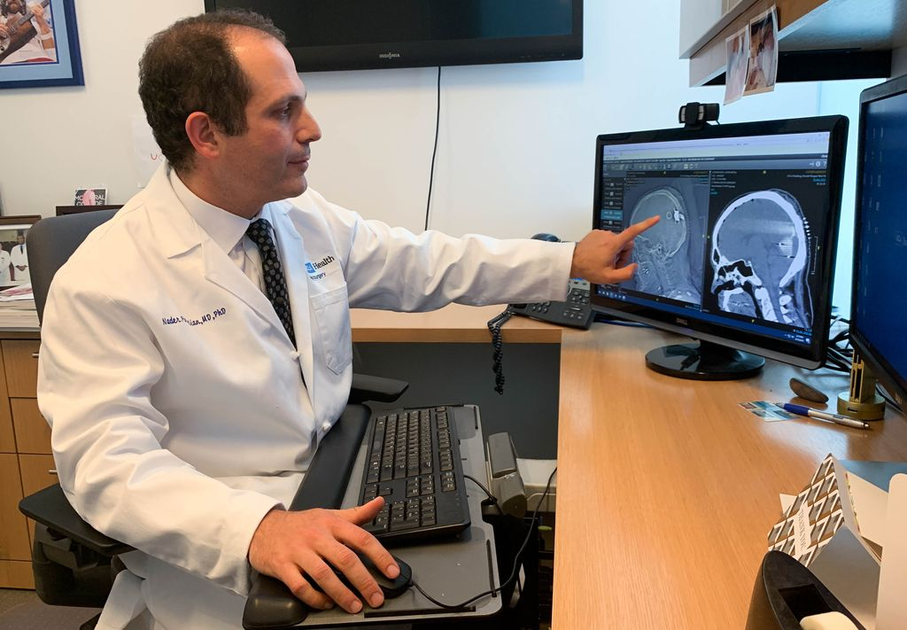 UCLA Health neurosurgeon Dr. Nader Pouratian points to an experimental device in the brain.