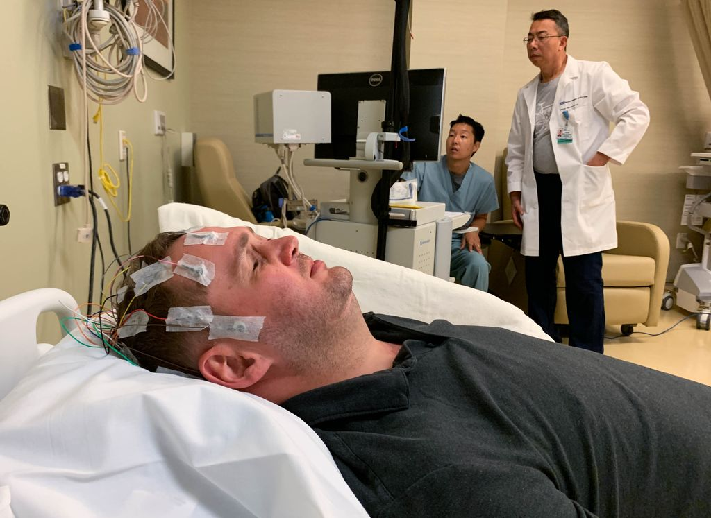 Researchers at UCLA Health use EEG to observe brain activity in Jason Esterhuizen.