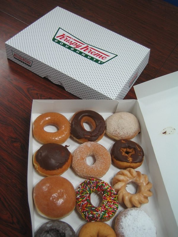 Krispy Kreme doughnuts - 1 box open, 1 box closed