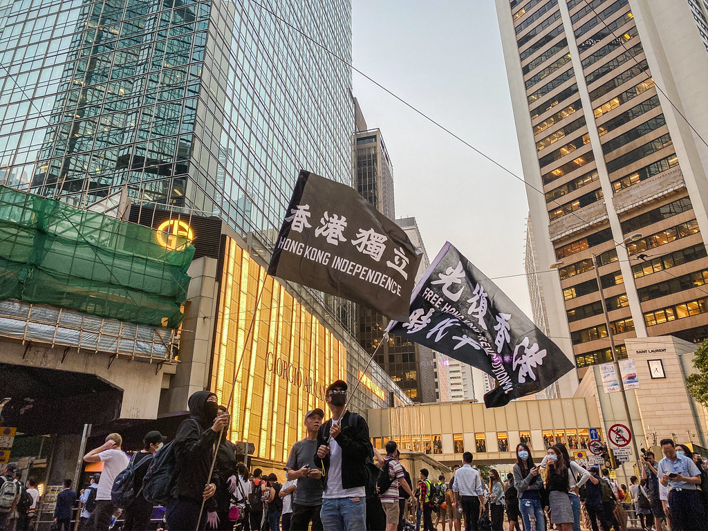 "Protester waving a banner saying ""Hong Kong Independence""."