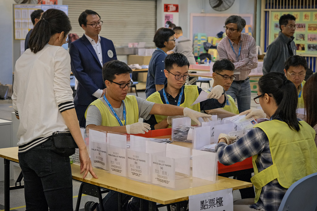 Workers counting votes in Hong Kong.