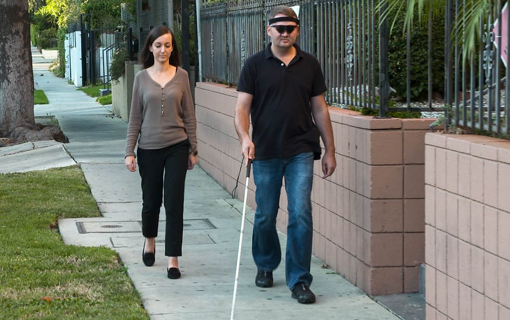 Jason Esterhuizen walks near his Los Angeles home with his wife, Sumarie.