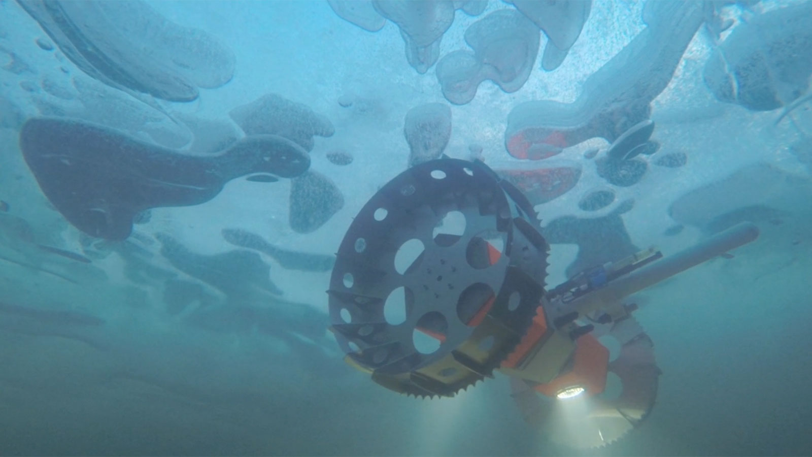 NASA's BRUIE, or the Buoyant Rover for Under-Ice Exploration, a two-wheeled underwater rover, is being tested under an Arctic lake.