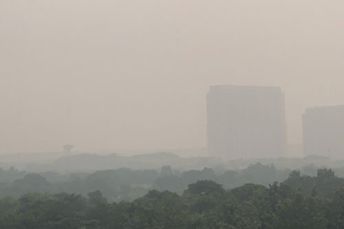 Smog-obscured view of buildings near New Delhi on 10-31-2019.