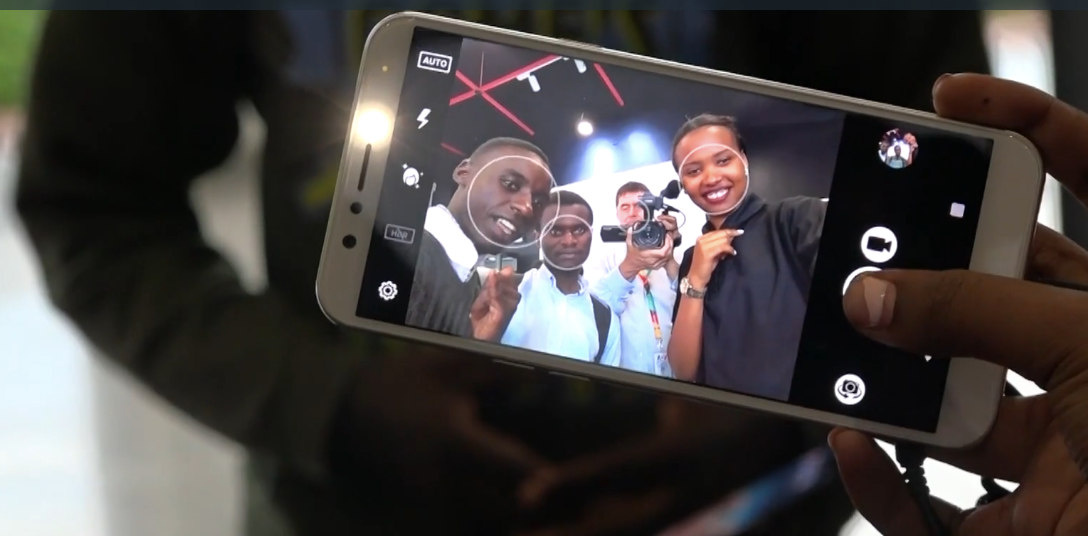 Shoppers test the selfie feature of the Mara phone.