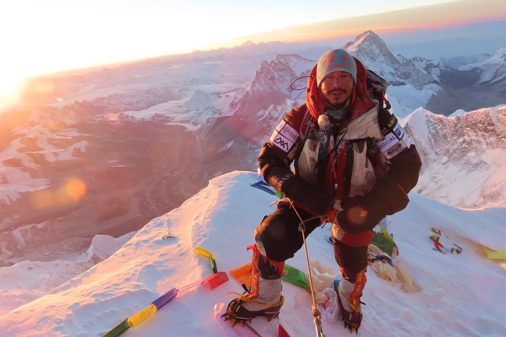 Nims Purja at the top of Everest.