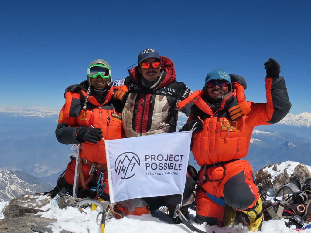 Nims Purja and some of his team members at the top of Nanga Parbat in Pakistan.