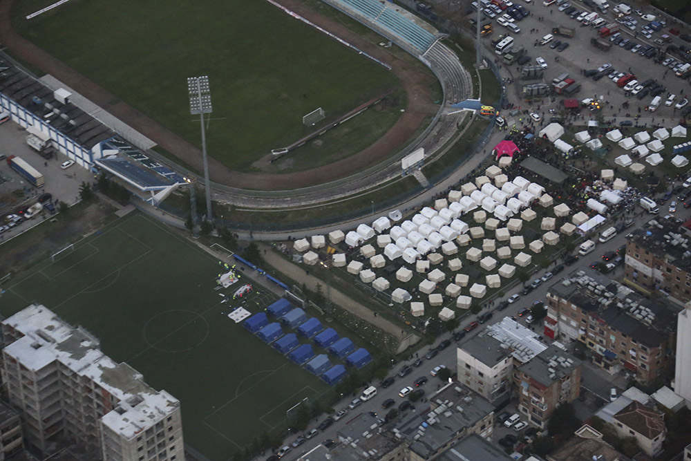 Aerial view showing emergency tents being set up on football fields as emergency housing for people displaced by the earthquake in Albania.