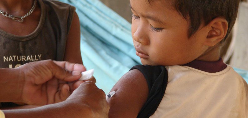 Cambodian boy receiving measles vaccine