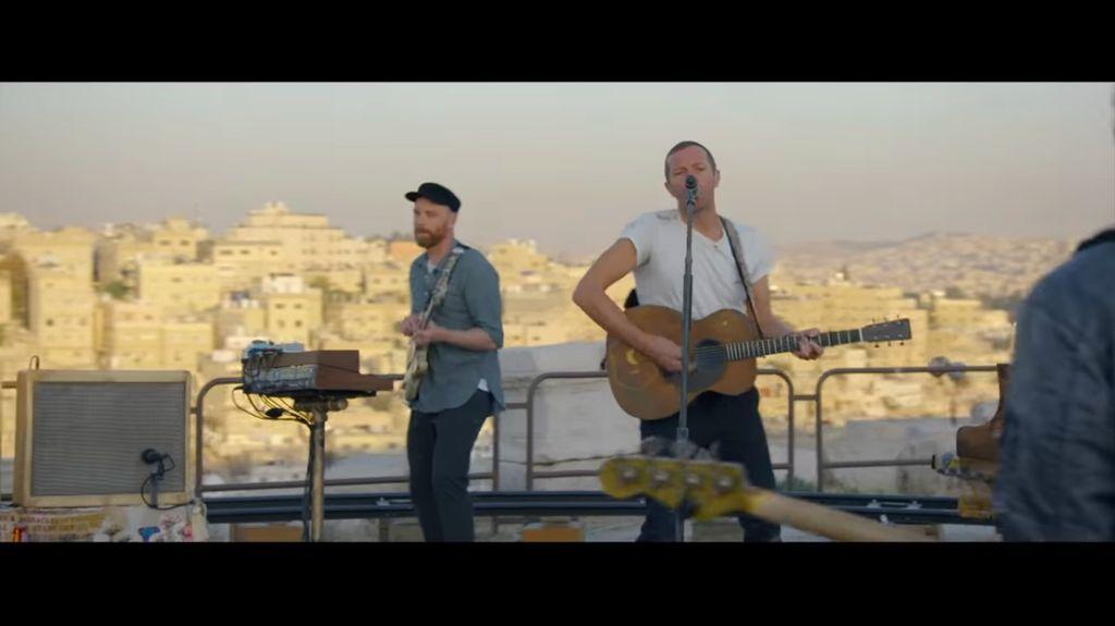 Coldplay performing in Jordan.