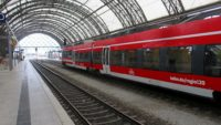 Red train at the Hauptbahnhof in Dresden, Germany.