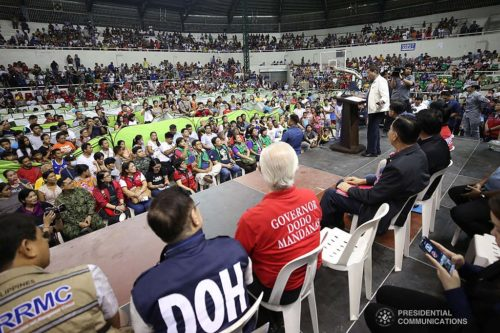 President Rodrigo Roa Duterte delivers a speech during his visit to the families affected by the Taal Volcano eruption at the Batangas City Sports Coliseum on January 14, 2020.