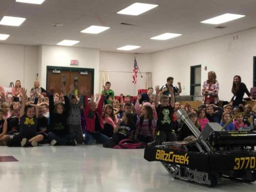 BlitzCreek 3770 Robotics team shows off their T-shirt Bot to local elementary school students.