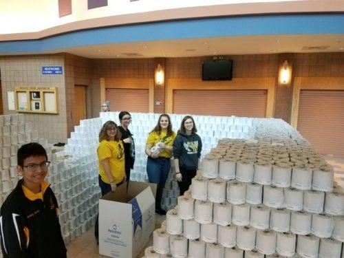 Members of the BlitzCreek 3770 Robotics team stand inside the toilet paper pyramid.