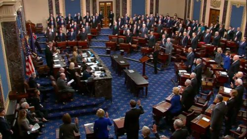 US Chief Justice John Roberts swears in Senators as the impeachment trial of Donald Trump begins in the US Senate.