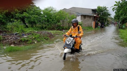 The picture shows flooding in a village outside of Jakarta on January 1, 2020.