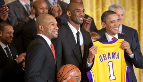 President Barack Obama holds a personalized team jersey presented to him by Los Angeles Lakers guards Kobe Bryant, center, and Derek Fisher, left, during a ceremony in the East Room of the White House honoring the 2009 NBA basketball champions, Jan. 25, 2010.