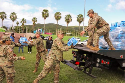 Puerto Rico's National Guard helps distribute bottled water after earthquakes in January, 2020.