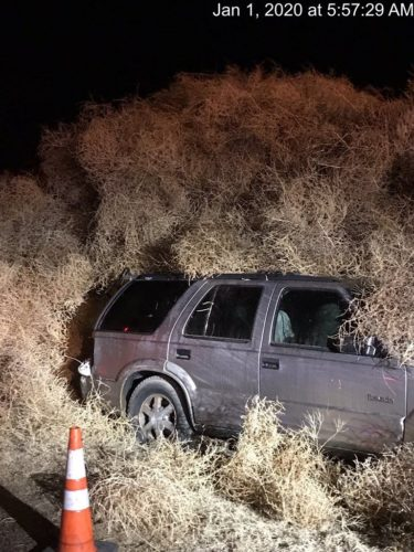 The Washington State Department of Transportation posted this picture of a car covered by tumbleweed.