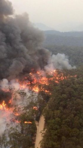 Fires continue to burn throughout Australia. This bird's-eye view was taken by aviation officer Sean Cox in early December.