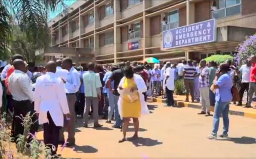 Doctors gather outside a hospital during a four-month strike by Zimbabwe's doctors.