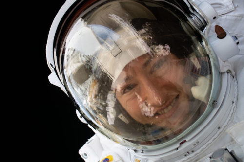NASA astronaut Christina Koch is pictured during a spacewalk she conducted with NASA astronaut Jessica Meir (out of frame) to install new lithium-ion batteries on Jan. 15, 2020.