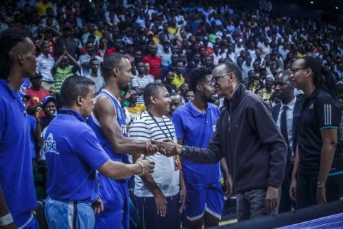 Rwanda's president, Paul Kagame, greets players on Madagascar's GNBC team.