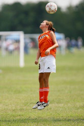 Girl Heading soccer ball