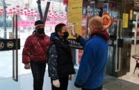 Customers who were measuring body temperature before entering the supermarket in Wuhan during 2019-nCoV coronavirus outbreak