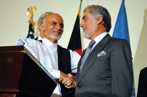 Afghan presidential candidate Ashraf Ghani shakes hands with rival candidate Abdullah Abdullah after both addressed reporters at the United Nations Mission Headquarters in Kabul, Afghanistan on July 12, 2014,