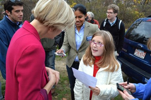 Elizabeth Warren talks with a young girl at a rally in Concord, Massachusetts 10/31/12