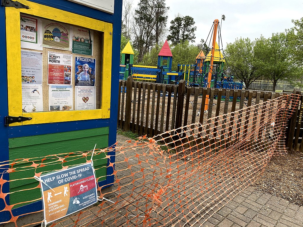 Wake County, North Carolina closed playgrounds on March 23, 2020 in response to the coronavirus outbreak. Apex, within Wake County, shuttered this playground with orange temporary fencing.