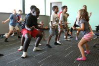 "DOBBINS AIR RESERVE BASE, Marietta, Ga., July 15, 2015 - A young camper leads the group during a kids yoga class at ""Camp Guard Youth 2015""."