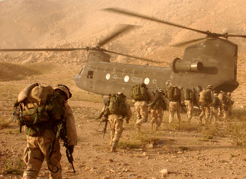 Soldiers return to a helicopter after searching in Daychopan district, Afghanistan, for Taliban fighters and illegal weapons caches.