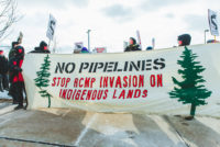 "Banner reads ""No Pipelines"" and ""Stop RCMP Invasion on Indigenous Lands"" - Wet'suwet'en Solidarity Event - Rail Yard near Pioneer Village Station Blockaded - Vaughan, Toronto, Ontario - February 15, 2020"