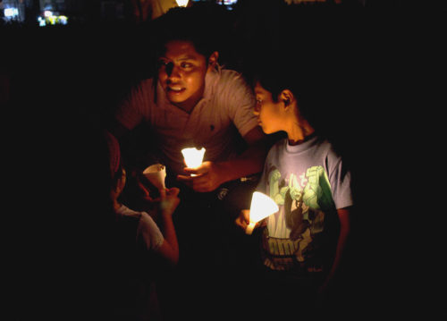 Earth Hour - family lit by small glowing lights