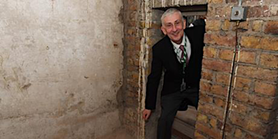UK Speaker of the House, Lindsay Hoyle, steps through a secret door.