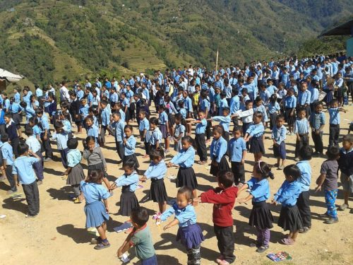 Kids stretching in front of a community school in Nepal