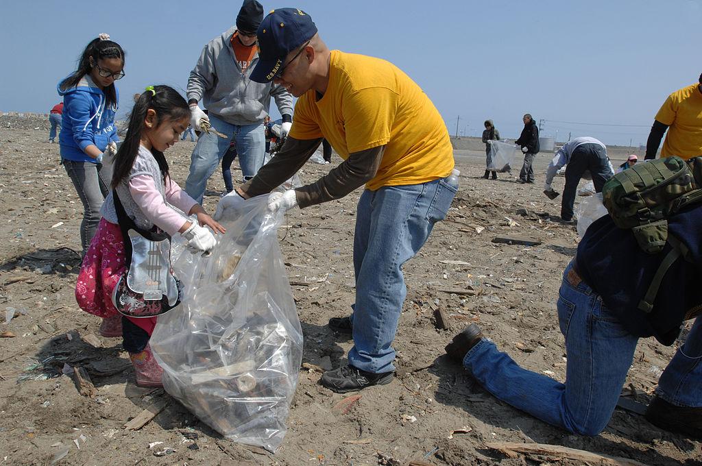 MISAWA, Japan (April 21, 2012) Chief Yeoman Ken Vinoya, center, helps gather trash at the Misawa Fish Port.