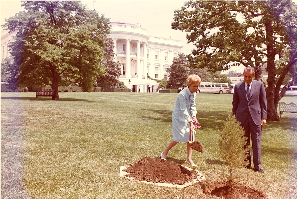 President and Mrs. Richard Nixon plant a tree on the White House South Lawn to recognize the first Earth Day.