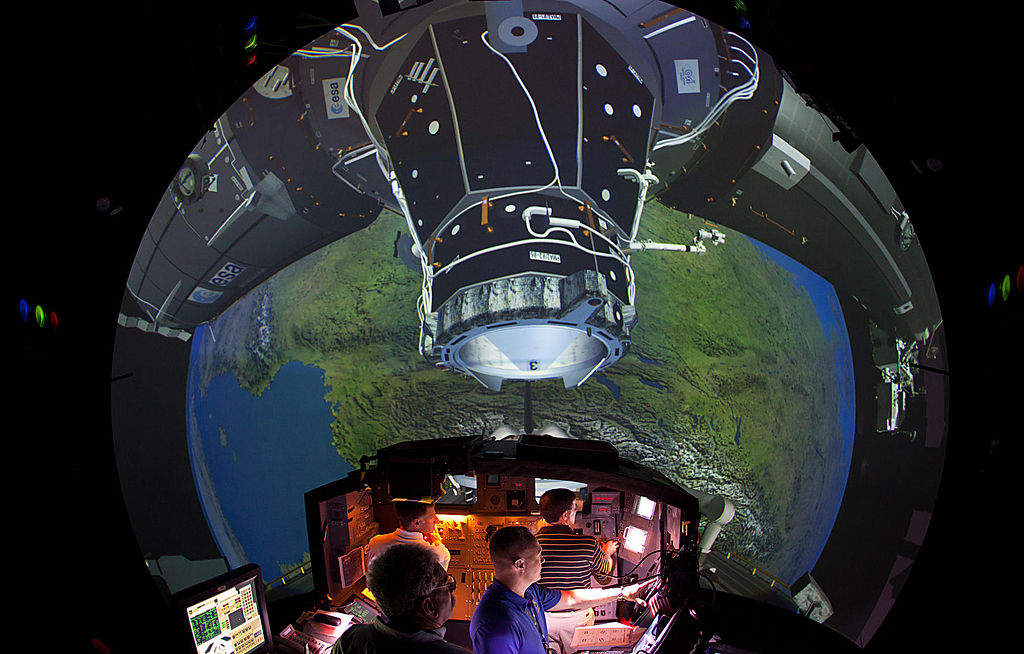 The Crew of STS-135 practices rendezvous and docking with the ISS in the Systems Engineering Simulator at the Johnson Space Center on June 28, 2011 in Houston, Texas.