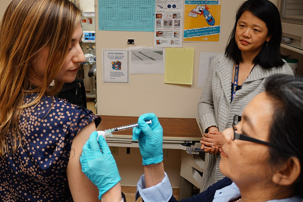 A healthy volunteer receives an experimental universal influenza vaccine known as H1ssF_3928 as part of a Phase 1 clinical trial at the NIH Clinical Center in Bethesda, Maryland. Scientists at NIAID's Vaccine Research Center (VRC) developed the vaccine.