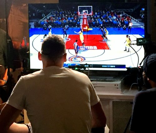 Los Angeles Clippers forward Sam Dekker pictured playing NBA LIVE 18 video game at the 2018 NBA All-Star Weekend in Los Angeles, California.
